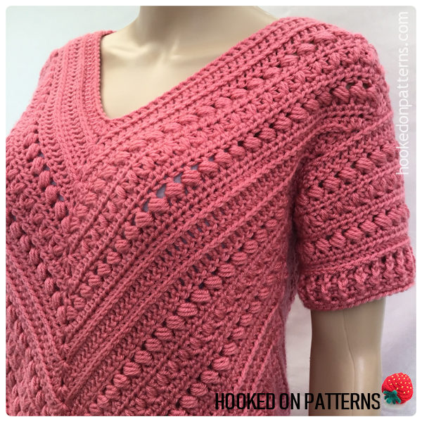 A close up shot of the Bonnie Tunic crochet pattern showing the detail of the textured stitches