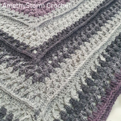 A thumbnail photo of the Clusters & Crosses Shawl free crochet pattern