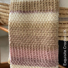 A thumbnail photo of the Marks In the Tunisian Ahavah Baby Blanket free crochet pattern