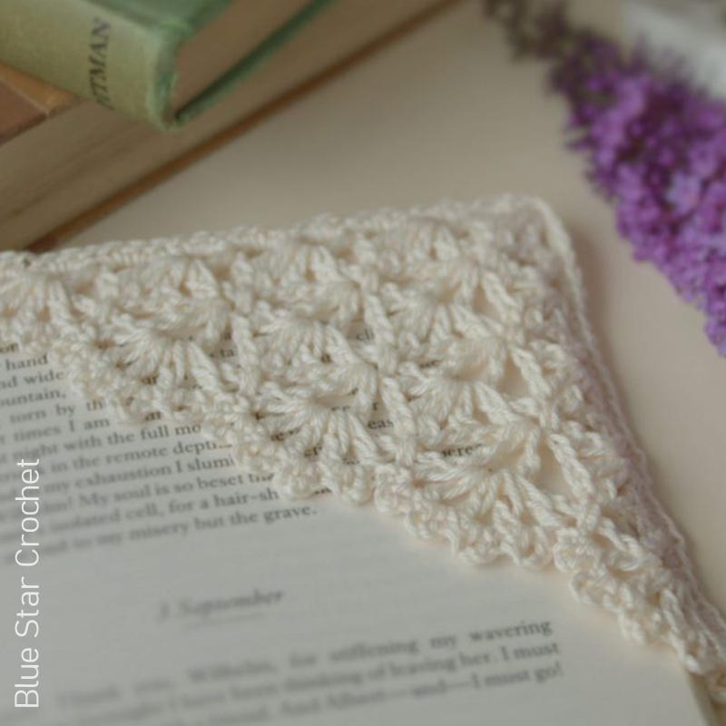 A photo of the Lotte Lace Crocheted Corner Bookmark on a book