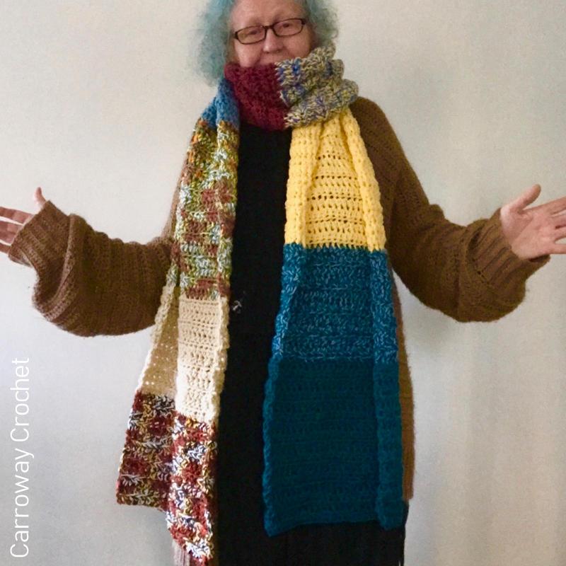 A photo of a model wearing a scrap yarn crocheted scarf