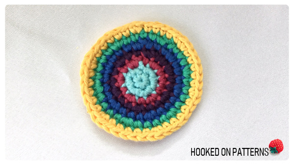 A photo showing the rainbow purse crochet pattern worked up to round 7