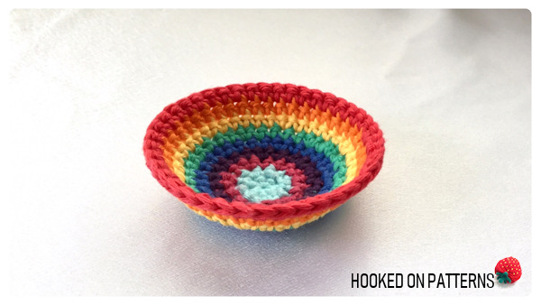 A photo showing the rainbow purse crochet pattern worked up to round 9