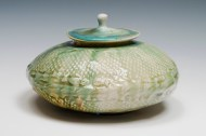 handbuilt jar utilizing a bisqued mould from a sunflower head. SOLD