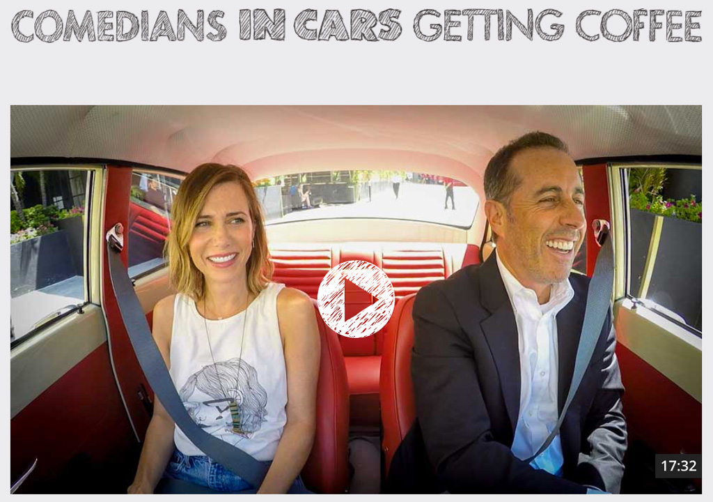 Kristen Wiig and Jerry Seinfeld riding in a Volvo Amazon