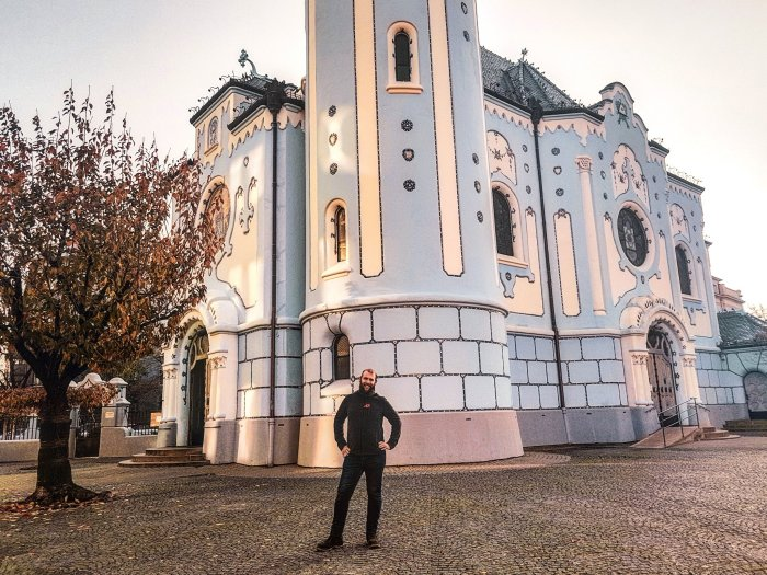 Henry standing outside the blue church-Bratislava-First-Timer's-Guide-Local-Guide