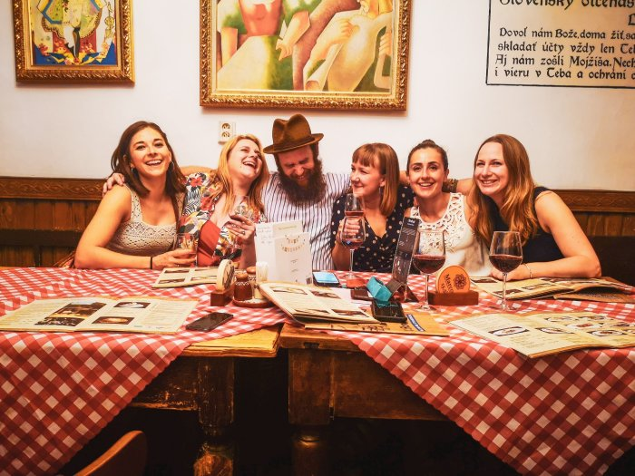 Henry with Jenni and four friends at a table--Bratislava-First-Timer's-Guide-Local-Guide