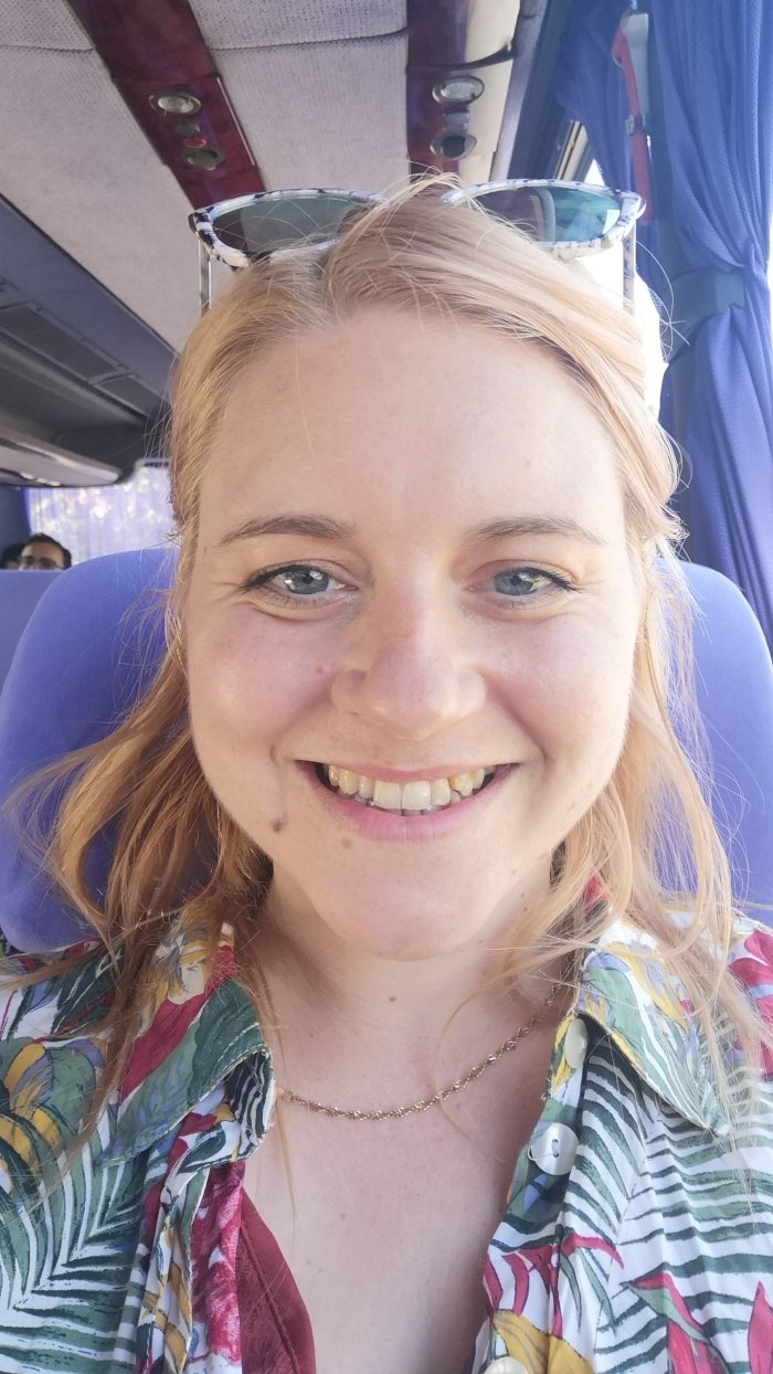 Jenni on a bus-Angloville-Honest-Review-Europe-Hoopla-Adventures