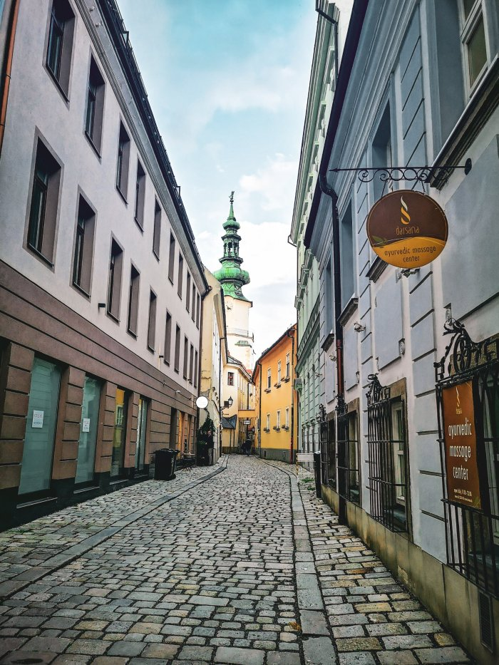 A cobbled street with a baroque city gate in Bratislava-Bratislava-First-Timer's-Guide-Local-Guide