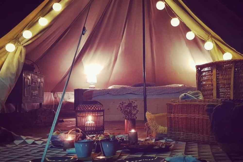 unique glamping tent in the night