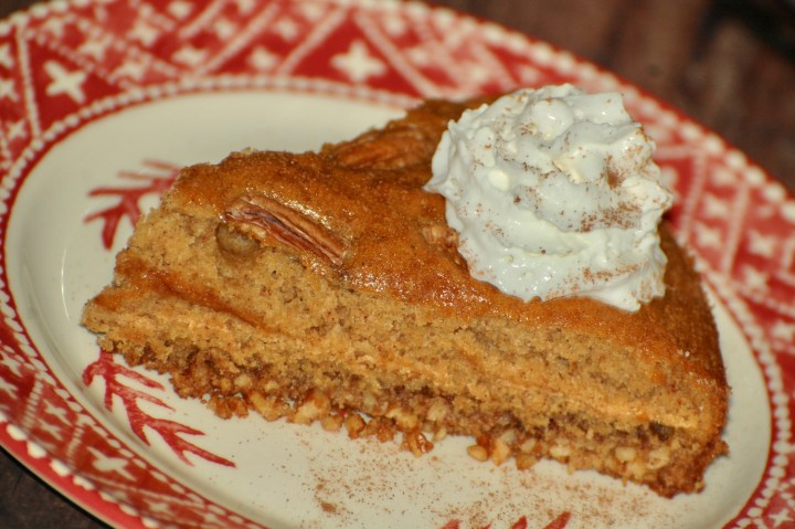 Close up picture of spice cake with whipped cream on top