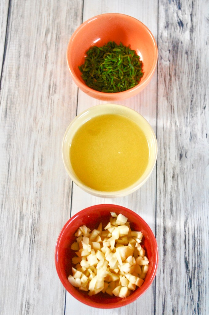3 small bowls of fresh thyme, lemon juice, and chopped garlic
