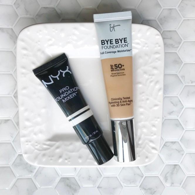 NYX Pro Foundation Mixer laying next to IT Cosmetics Bye Bye Foundation Full Coverage Moisturizer
