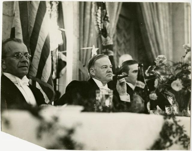 Former president Hoover attending a dinner in Prague, March 4, 1938.