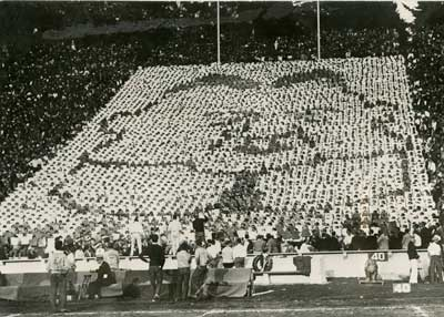 """""""A unique portrait of Herbert Hoover as formed by the cheering section of the University of California during a Cal-Stanford football game."""" 11/27/1928"""