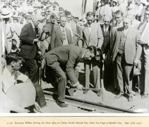 Secretary Wilber driving the silver spike on Union Pacific Branch line from Las Vegas to Boulder City, 09/17/1930