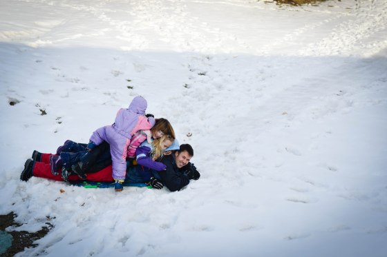 four kids, a dad and a sled.