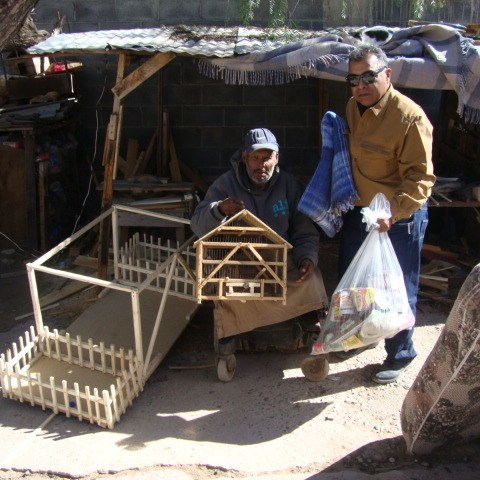 Avaristo Gonzales, has no legs, gets around in his electric wheel chair. He says his wheel chair is failing, does not charge well or the batteries are dying. He supports himself by making wood crafts like bird cages, tiny houses with sheds for religious sceneries.