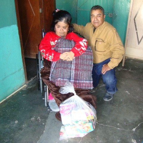 Cholita Domingez, is wheel chair bound, her head is deformed and mentally ill, her mother cares for her, they are very low income. Cholita can barely hear and talk.