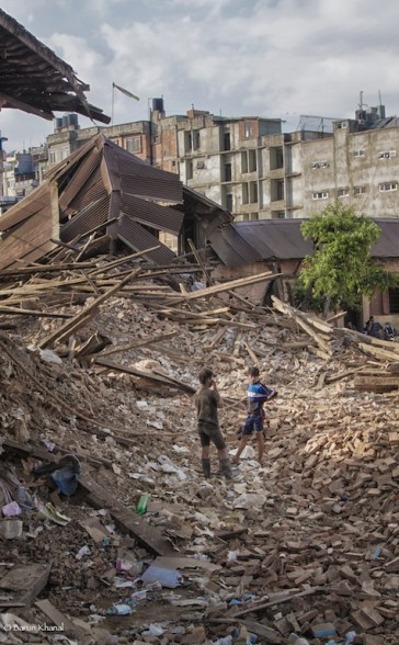 Two boys in between the pile of collapsed temple near Tripureshwore