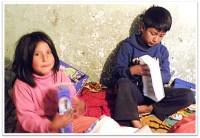 Children enjoying their gifts