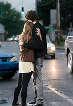 Couple hugging by street