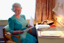 Queen Elizabeth works at her desk on the Royal Train in May, 2002. ©anwarhussein.com
