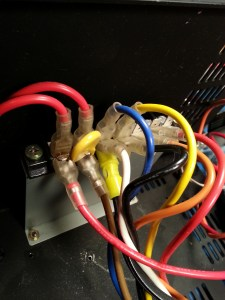 Original AC wiring block. Long wires snake through the amp chassis to this terminal block.