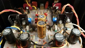 The four capacitors in the foreground are added for extra smoothing of the power supply to the input board. On the underside of the board are 0.1uF WIMA MKS poly caps in parallel with these Nichicon Muse electrolytics.