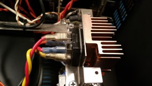 Heatsinks are added to the upgraded 50A bridge rectifiers to keep their heat from flowing into the power supply capacitors, and to prevent sag under load. Heat-failure of this bridge is probably rare, but I have seen one example.