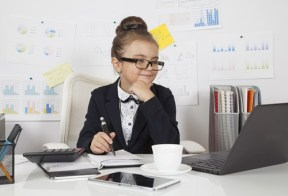 Little girl dressed up as a grown-up boss