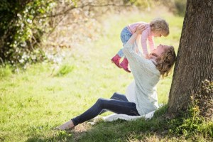 mother playing with a daughter in a park