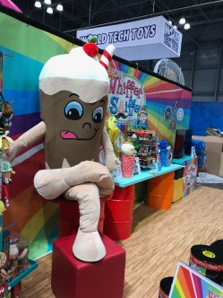 A huge soda Whiffer Sniffers mascot at Thai NY Toy Fair booth.