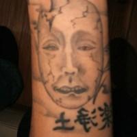 能面のタトゥー画像