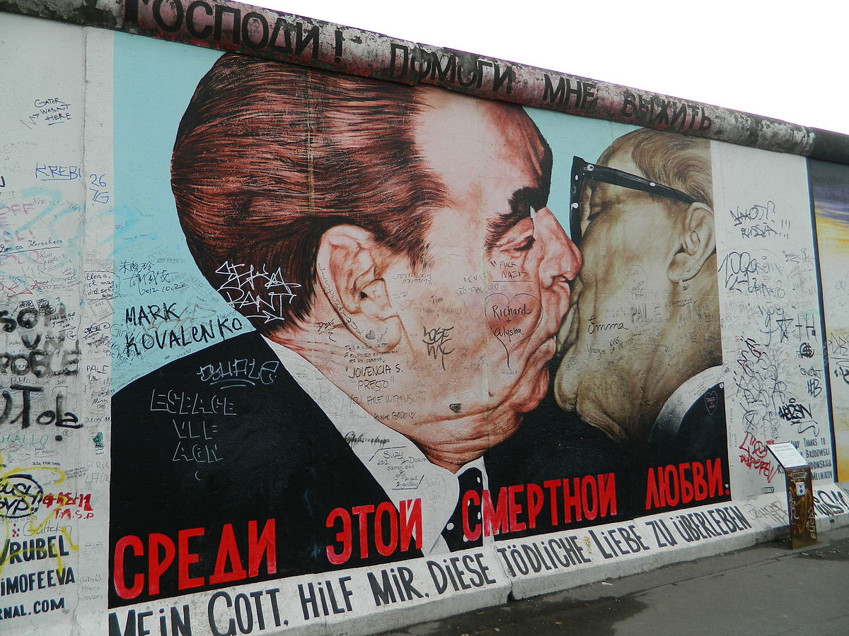 The 'Fraternal Kiss' mural, by Soviet artist Dmitri Vrubel, emblematic of the Cold War, appeared on the Berlin East Side Gallery, Berlin Wall, 1990.