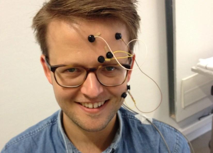 Electrodes placed over face muscles help Dr Bakker infer the feelings of test patients. Image credit—Dr Bert Bakker