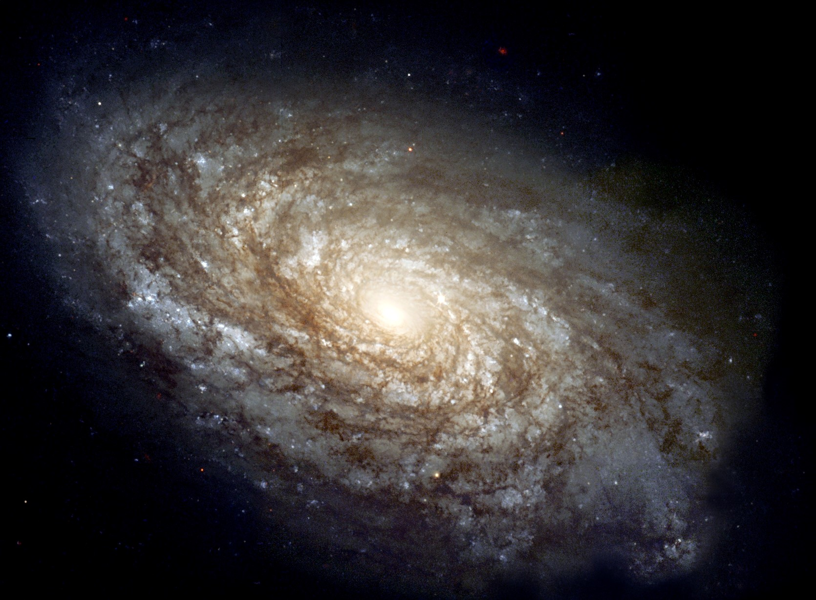 Cosmic dust is too cold to be captured by optical telescopes, so visual images of galaxies don't give the full story of conditions.