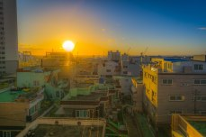 Caught this sunrise on a rare clear morning from our apartment overlooking Donggu