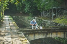 At the beginning of the Philosophers path an artist was drawing as he sat on this bridge.