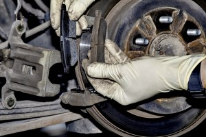 mechanic-changing-brake-pads-1024x683