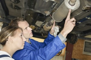 mechanic-showing-female-trainee-exhaust-maintenance-1024x680