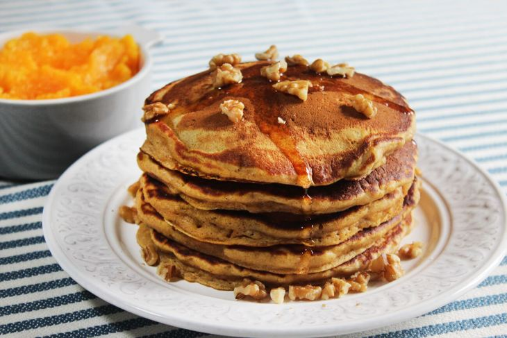 Pumpkin pancakes with maple syrup and pecan nuts