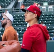 Tres Barrera, Texas Alum, watches the practice-
