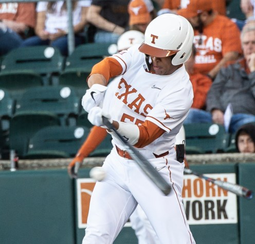 Texas infielder Cam Williams at the plate-