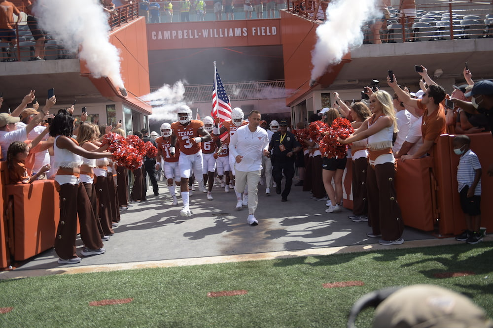 Sarkisian leads team on field at DKR