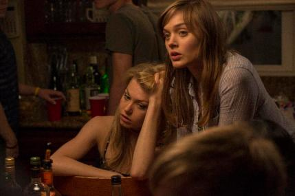 """(L-R) Penelope Mitchell as Tracy and Bella Heathcote as Chrissie in the thriller """"THE CURSE OF DOWNERS GROVE"""" an Anchor Bay Entertainment release. Photography credit: Bryan Giardinelli."""