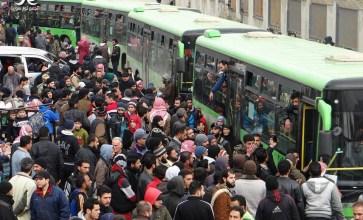 الوداع المؤلم – مهجرو حي الوعر في حمص – عدسة حسن الأسمر
