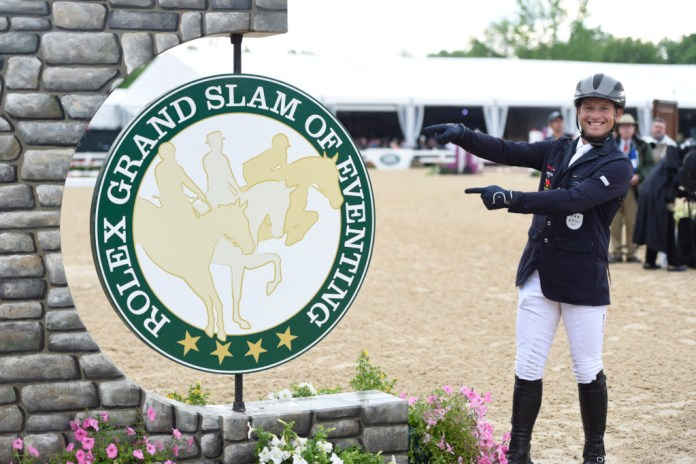 Michael Jung points to the Rolex Grand Slam of eventing sign. Will he win it next week? Photo Rolex / Kit Houghton
