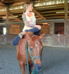 Julie-Horseback-Baradvajasana