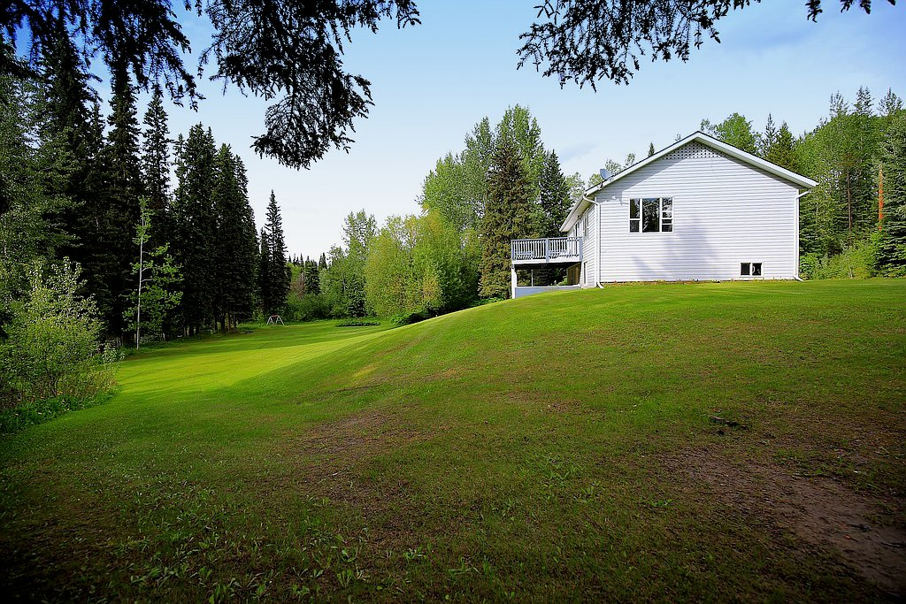 Gorgeous riverfront property with 3-bedroom home on 4.7 acres - 3439 Little Horsefly Road